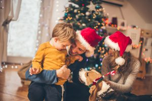 Little boy spending time enjoying with his family on Christmas morning